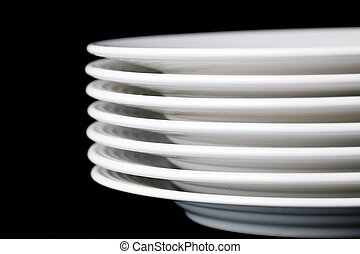 white plate on black background