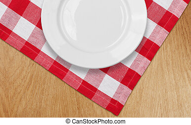 white plate on kitchen table with red checked tablecloth