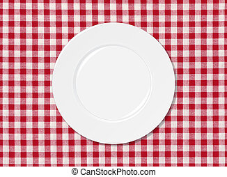 White plate on red and white striped seamless tablecloth...