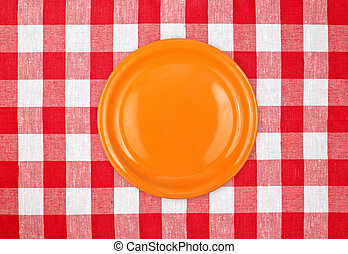 white plate on red checked tablecloth