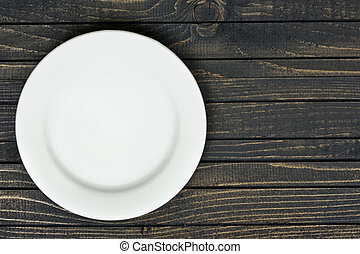 White plate on table