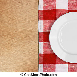 white plate on table with red checked tablecloth