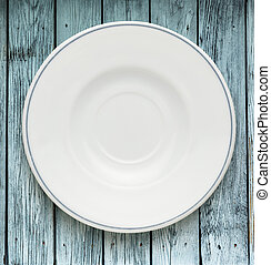 White plate on wooden background