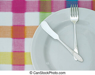 White Plate - White plate, fork and butter knife over a...