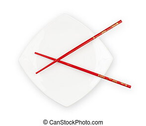 White plate with red chopsticks isolated with clipping path included