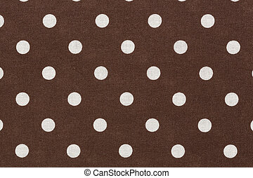 White polka dots on brown fabric background.