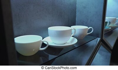 White porcelain coffee cup in a cafe or in the kitchen -...