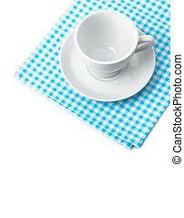 White porcelain mug with saucer tableware on cellular napkin