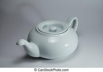 white porcelain tea-pot on a light background, studio illumination