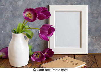 White poster frame mockup with  purple flowers in a vase