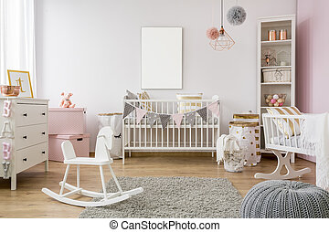 White poster mockup over crib in pastel baby room