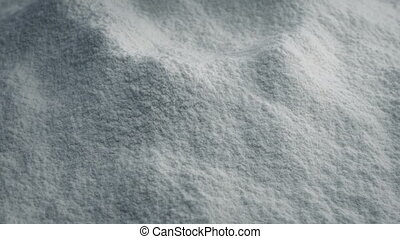 White Powder Rotating - Generic powder in strong lighting,...