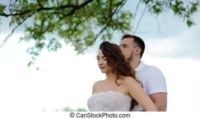 White pregnant young woman and her husband