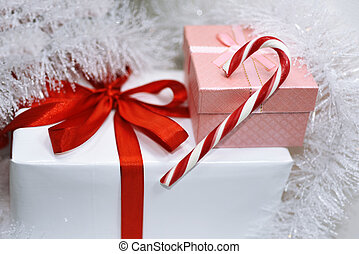 White presents with red ribbons