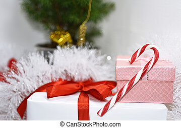 White presents with red ribbons.