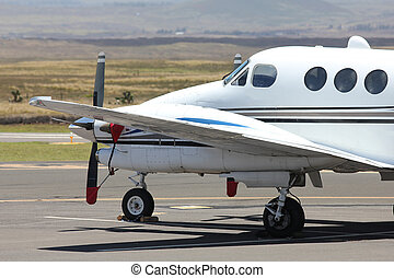 white prop plane