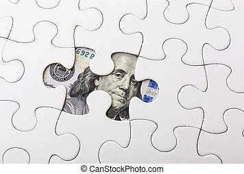 White puzzle and US banknote