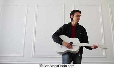 white quitar performer