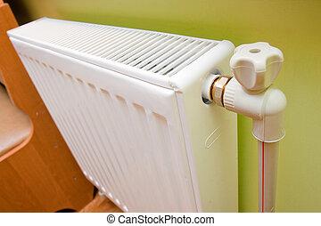 radiator - White radiator with radiator thermostat at home.