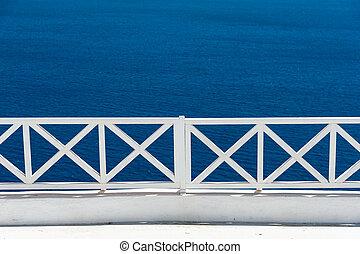 White railing over the sea of Santorini