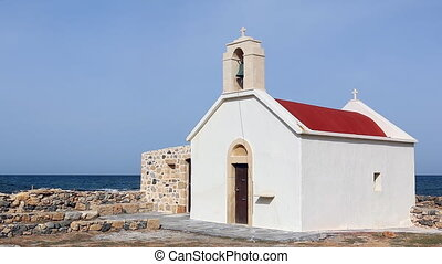 White red small church on a seashor