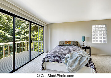 White refreshing bedroom interior with walkout deck - White...