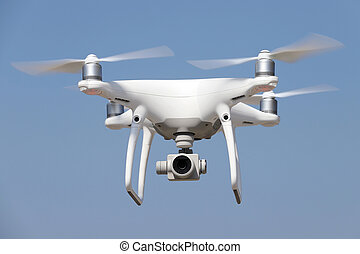 White remote controlled drone flying - White drone quad...