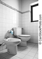 White Restroom - Black and white image of a restroom with...