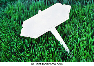 White retro lable put on green grass