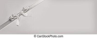 White ribbon bow on white