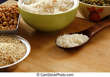 white rice is on wooden background.