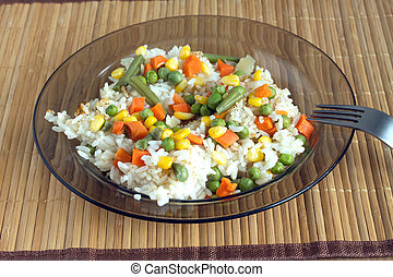White rice with vegetables on plate