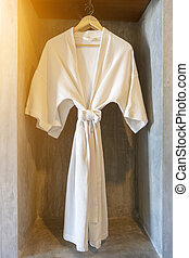 White robe in the Closet with cement background