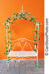 white romantic vintage chair with orange wall