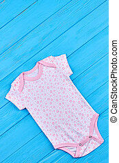 White romper with pink flower pattern.