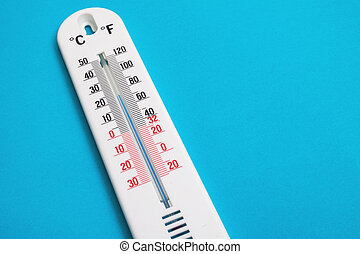 White room thermometer on a blue background