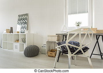 White room with crystal chair