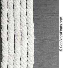 White rope on black background