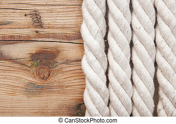 White rope on old wooden background
