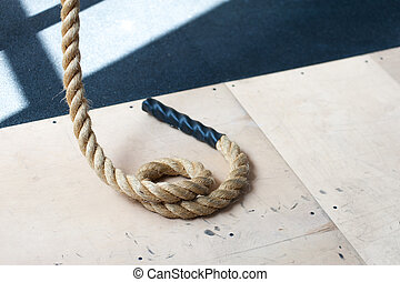 White ropes on the floor in a gym for fitness workout
