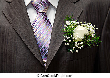 boutonniere - White rose boutonniere on groom's wedding suit
