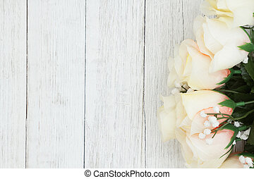 White roses bouquet on weathered whitewash textured wood background