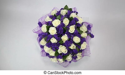 White roses flowers bouquet with violet decor. top view