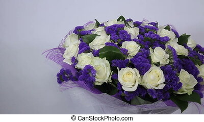 White roses flowers bouquet with violet decor