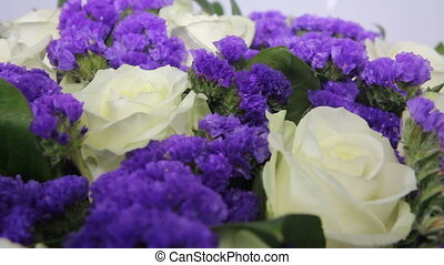 White roses flowers bouquet with violet decor. close up