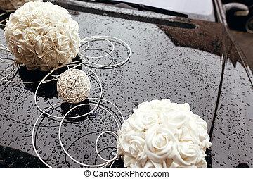 white roses wedding decor on black luxury car, adorning and ...