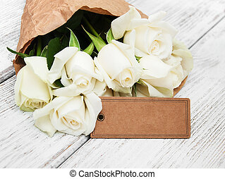 White roses with tag