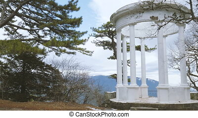 White rotunda in mountains - White rotunda on the background...