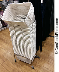 white row basket in clothing store shop