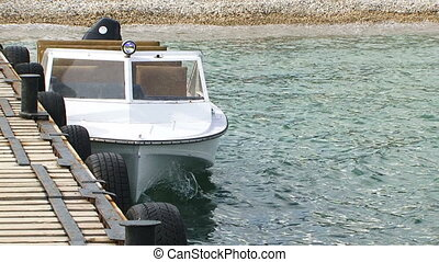 White Sailboat Drifting At Dock In Black Sea